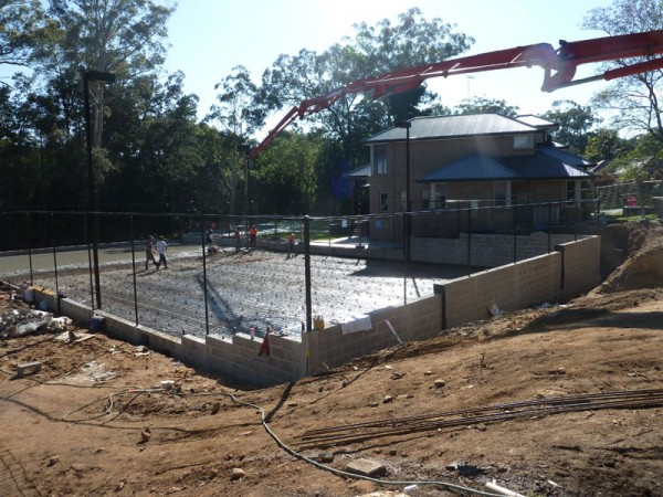 residential tennis court construction in progress